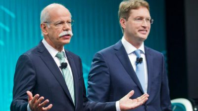 Ola Kallenius, right, stand with Daimler Chairman Dieter Zetsche