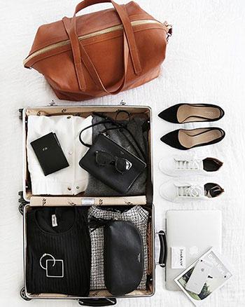 راهنمای چیدن لباس در چمدان